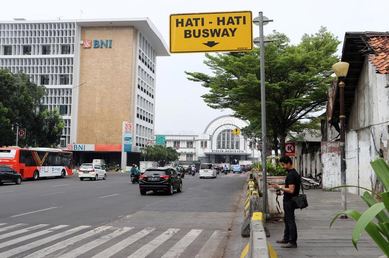 The traffic on the Lada road in front of Jakarta Kota railway station at the west Jakarta stock photos