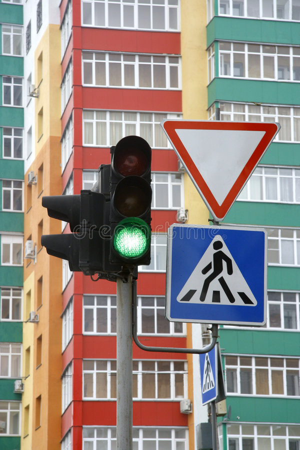 Traffic light. Against a multi-colour high building stock photography