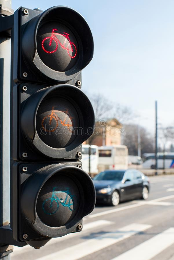 Traffic light for a bicycle near a highway in the city royalty free stock image