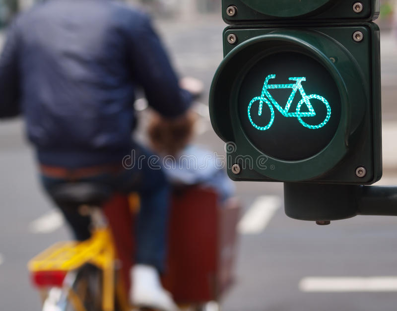 Traffic light bike sign. In Germany with man riding his bike on the background royalty free stock images