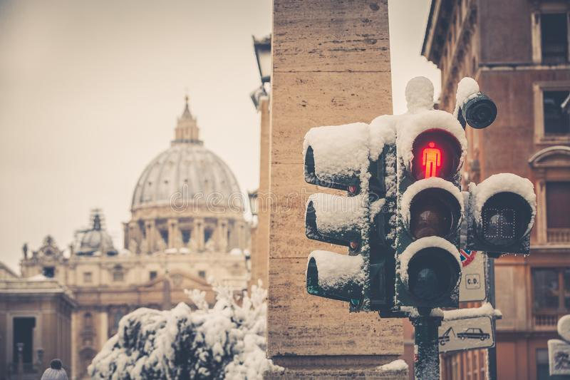 Traffic light covered with snow. Saint Peter, Rome Italy. stock images