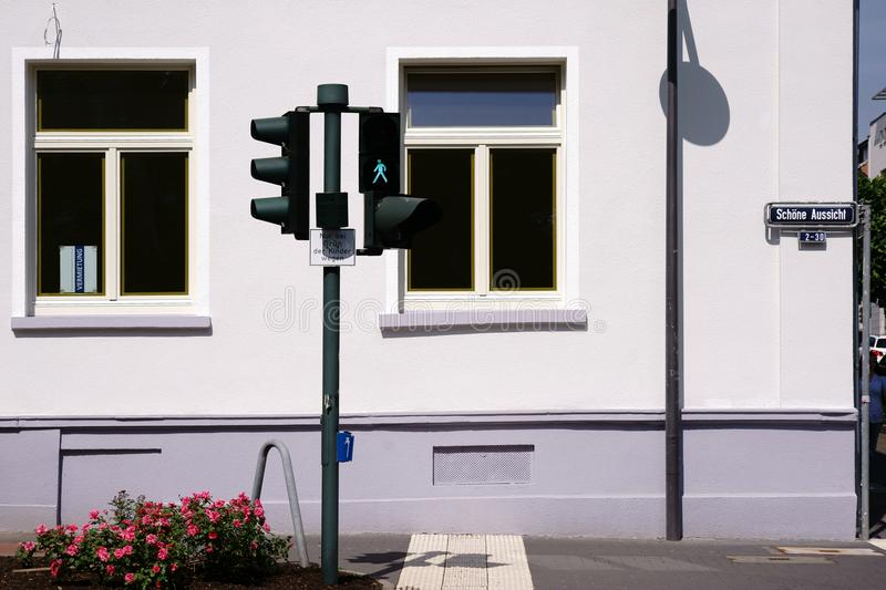 Traffic light crossing in front of residential building stock photos