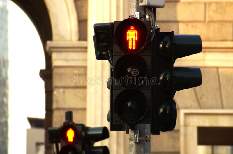 Traffic light. Pedestrian traffic lights in the city of Milan royalty free stock photo