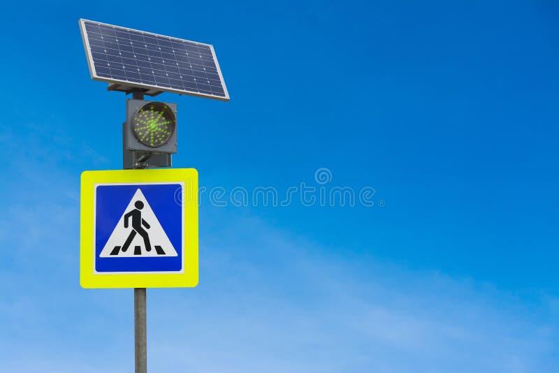 Traffic light powered by solar panels stock image
