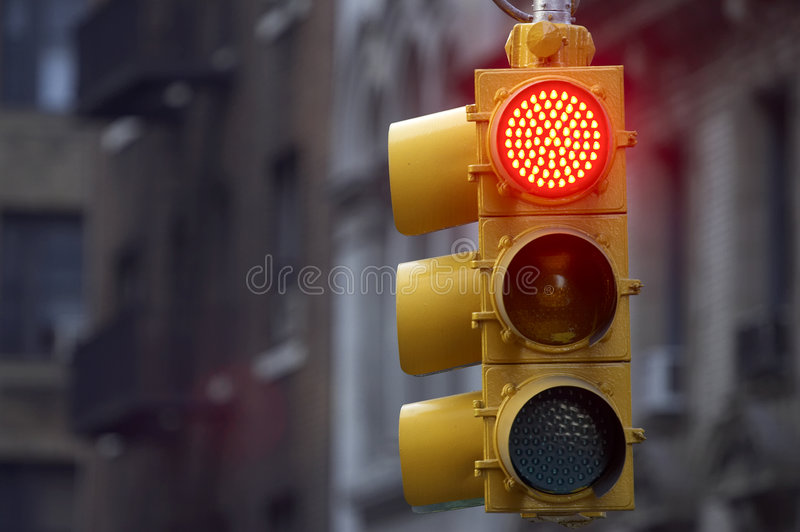Traffic light on red stock photos