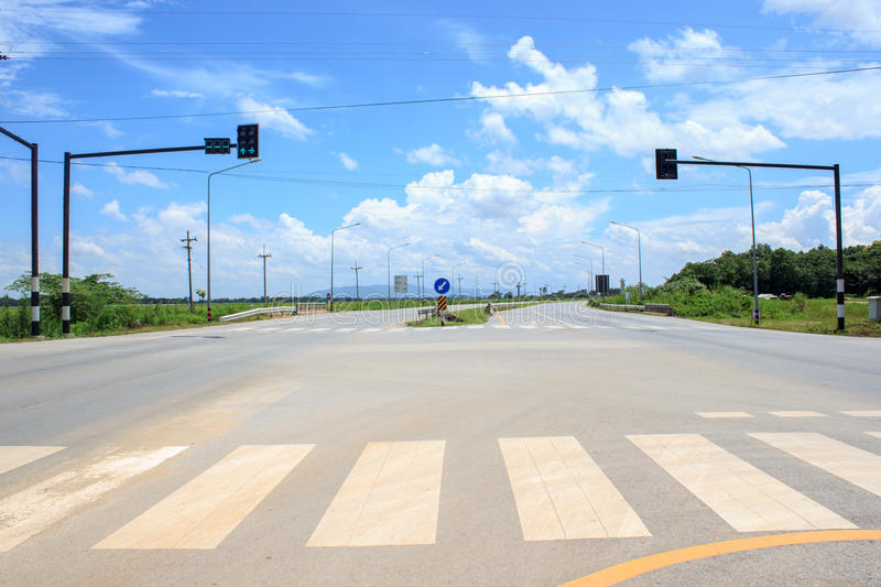 Traffic light on the road no bike and car. Empty road with clouds and sky background royalty free stock photos