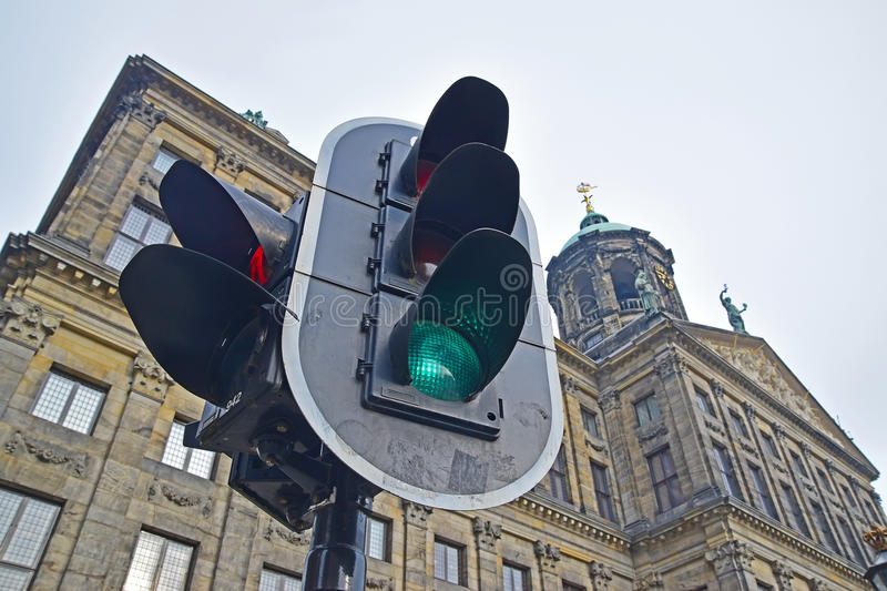 Traffic light with Royal Palace in the background at Dam Square stock image