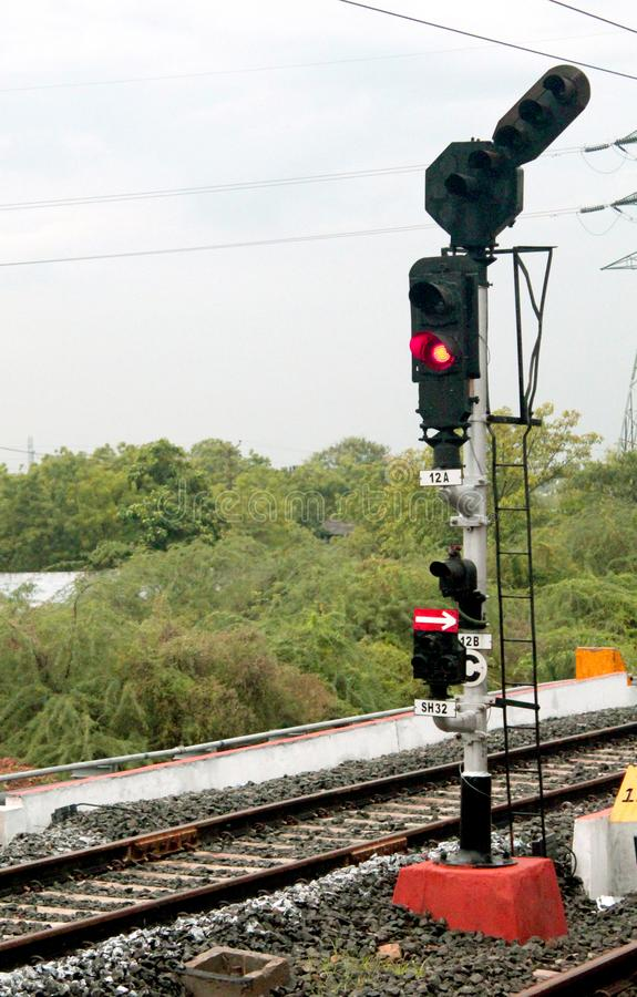 Traffic light shows red signal on railway. Traffic light shows red signal on india railway-india rail road landscape photo royalty free stock images