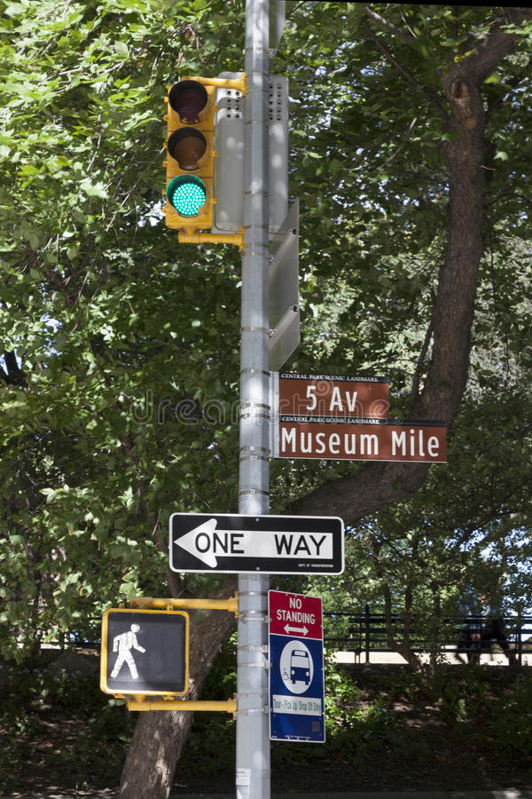 Traffic light and sigh indicating museum mile on 5 av new york city stock image