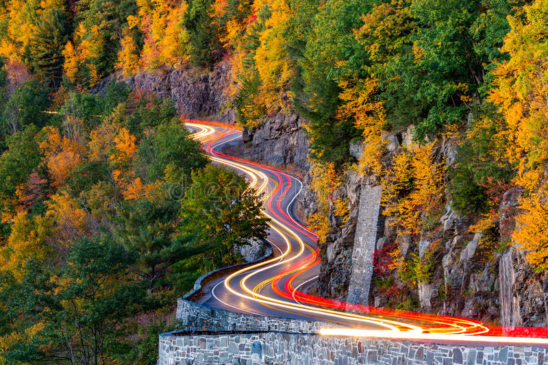 Traffic light trails on Hawk's Nest winding road royalty free stock photo