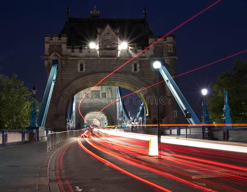 Traffic light trails in the Tower Bridge in London royalty free stock photography