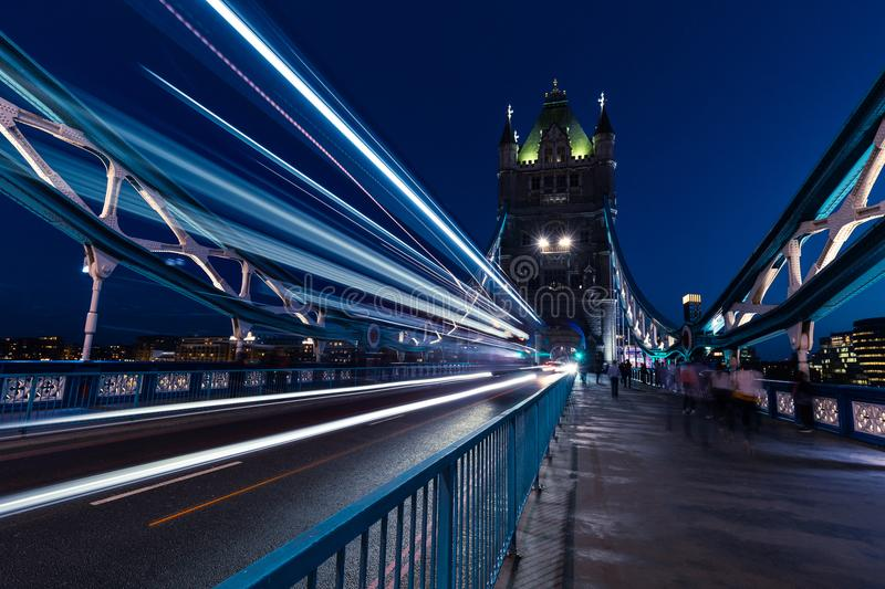Traffic light trails on Tower Bridge in London at night royalty free stock photography