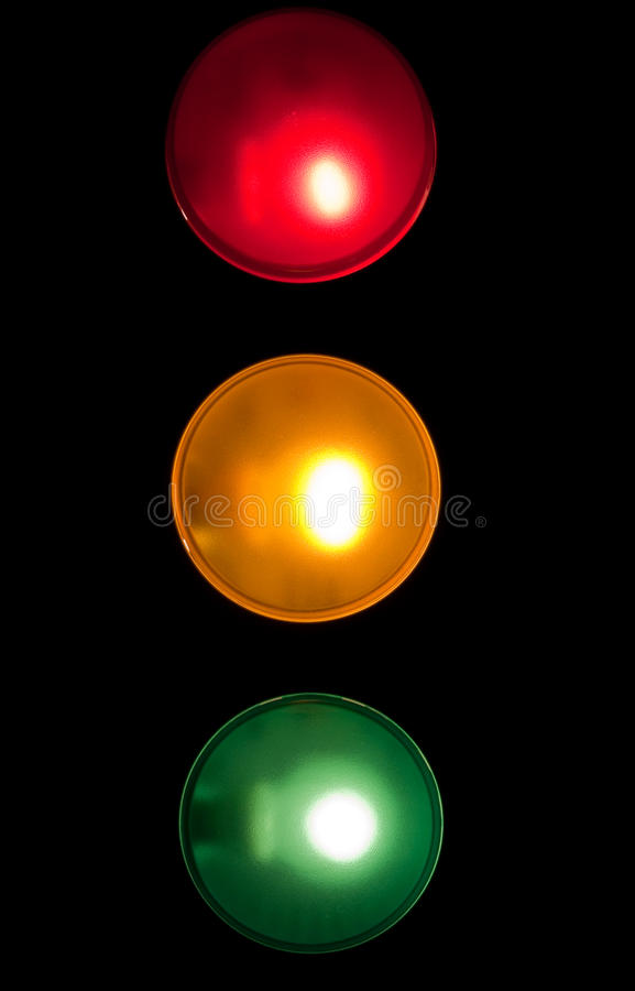 Traffic Lights. Red, amber & green lights representing traffic signals stock image
