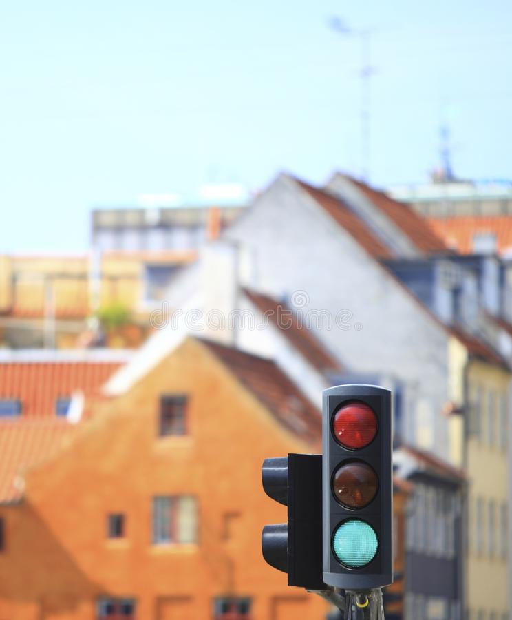 Traffic Lights Against City Background Stock Photography