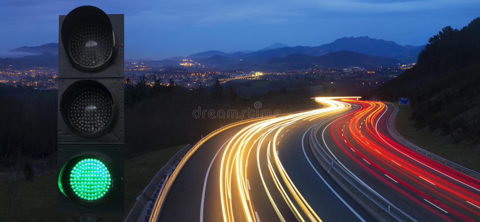 Traffic lights and car lights at night royalty free stock photography
