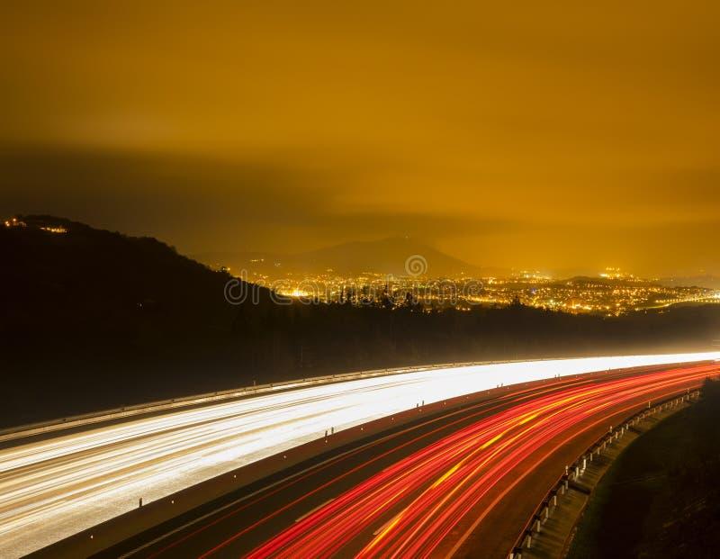 Traffic lights, car lights at night royalty free stock photos