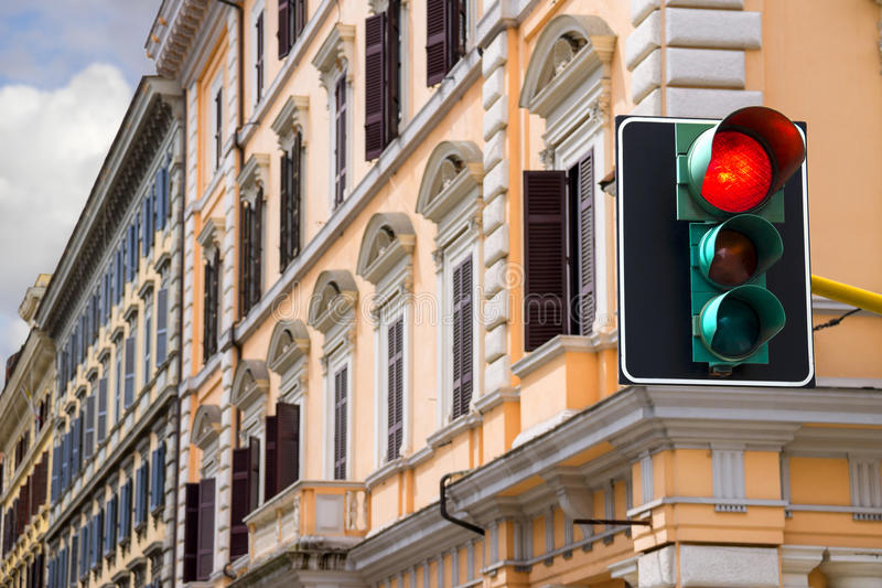 Traffic lights at the crossroads of the city is lit red stock image