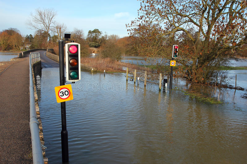 Download Traffic Lights On A Flooded Road. Stock Photo - Image: 36571900