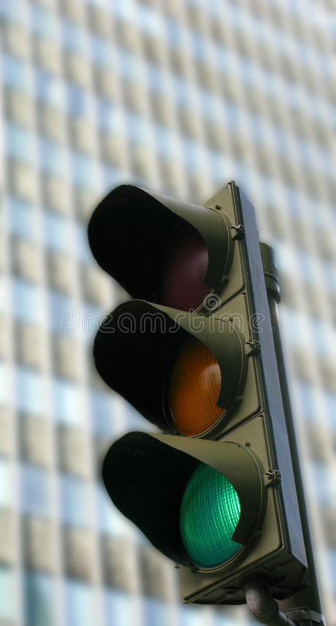 Traffic lights on green stock photography