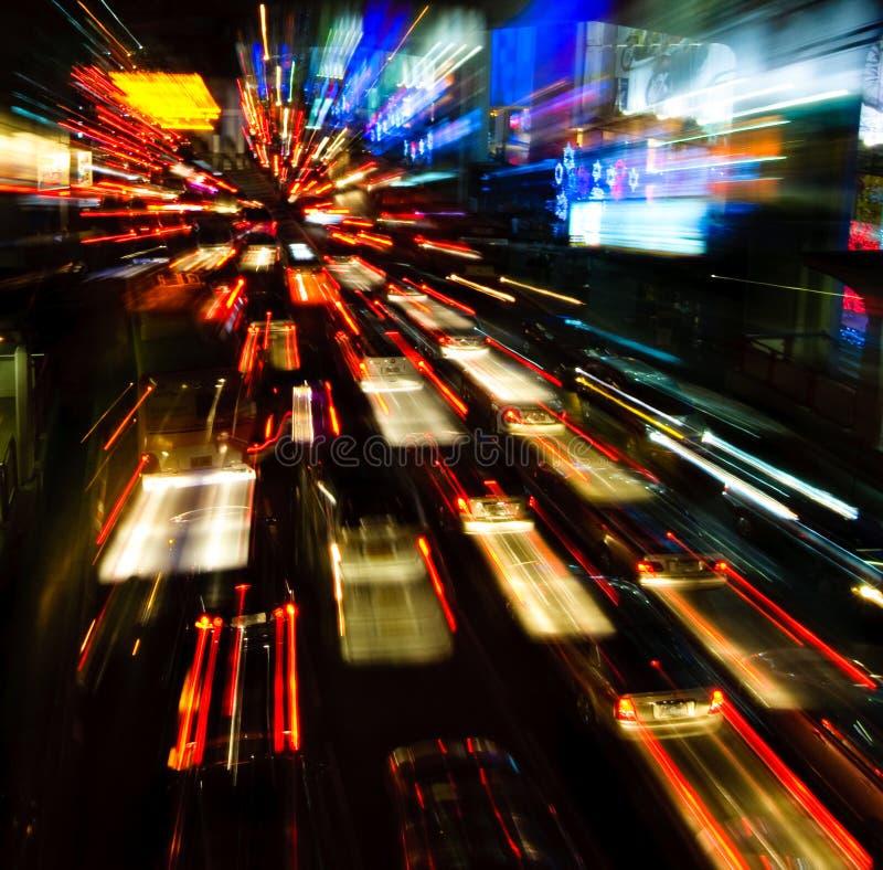 Traffic lights in motion blur. Vibrant traffic lights in motion blur stock image