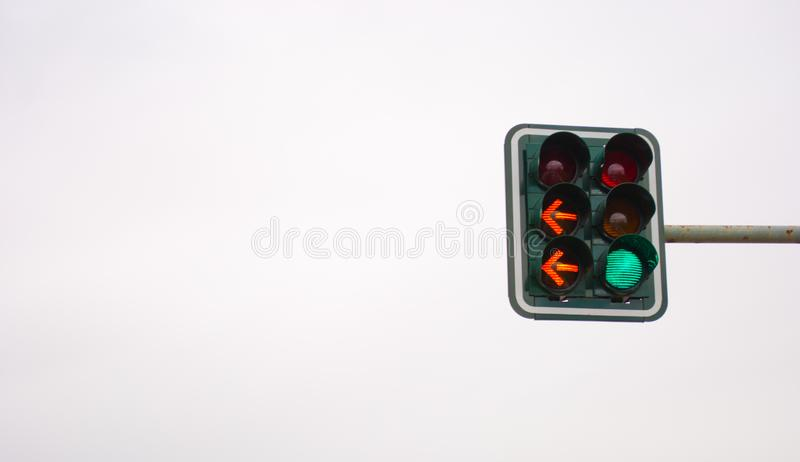 Traffic lights with red color isolated on the grey background. Horizontal laconic image of city traffic lights with green and red colors switched on stock photos