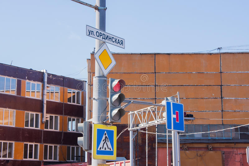Traffic lights and road signs on a pole. On the background of buildings royalty free stock photos