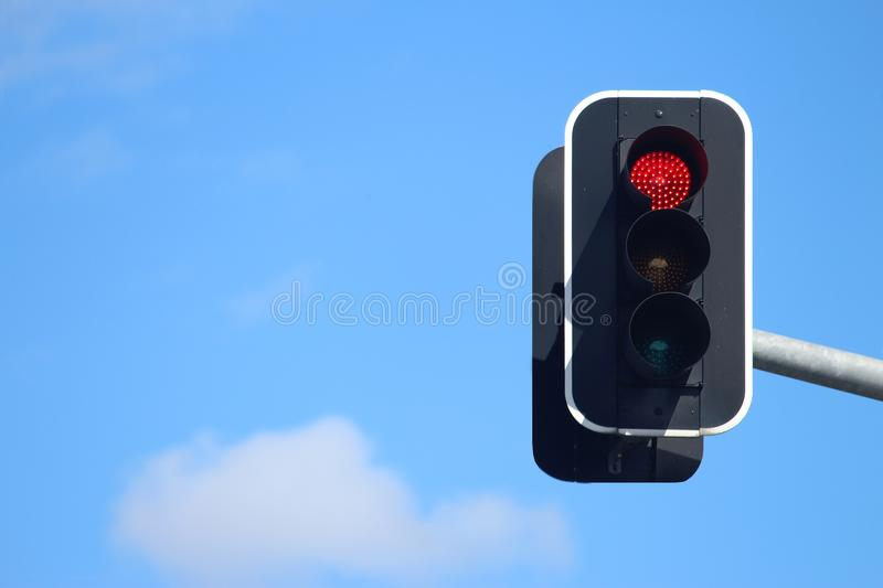 Traffic lights suspended showing stop stock photos