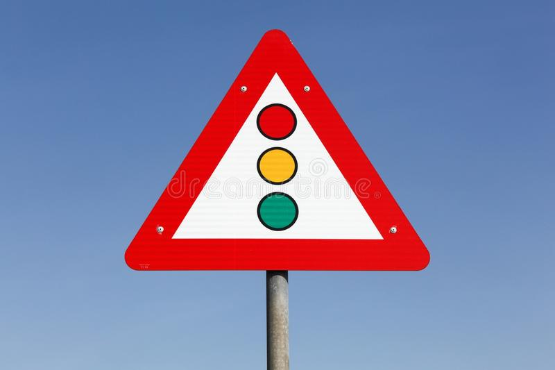 Traffic lights warning triangle sign stock photo