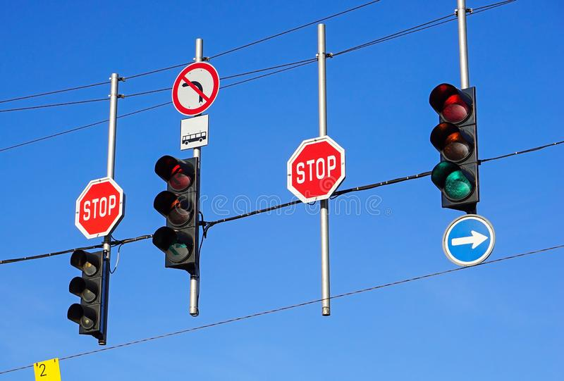 Traffic lithts and stop signs at the road crossing. Outdoor royalty free stock photography