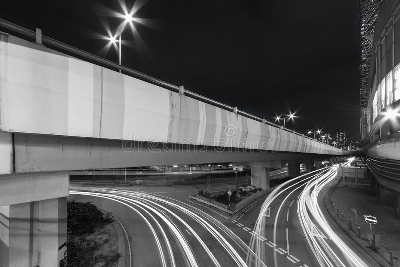 Light trails of night traffic in midtown stock photography