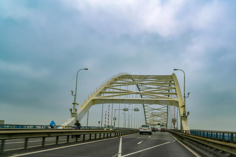 Traffic with motion blur on white metal bridge, Nederland, Holland stock image