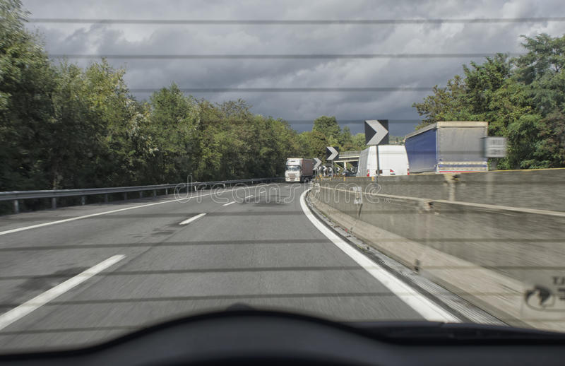 Traffic of the motorway from the back of a car stock images
