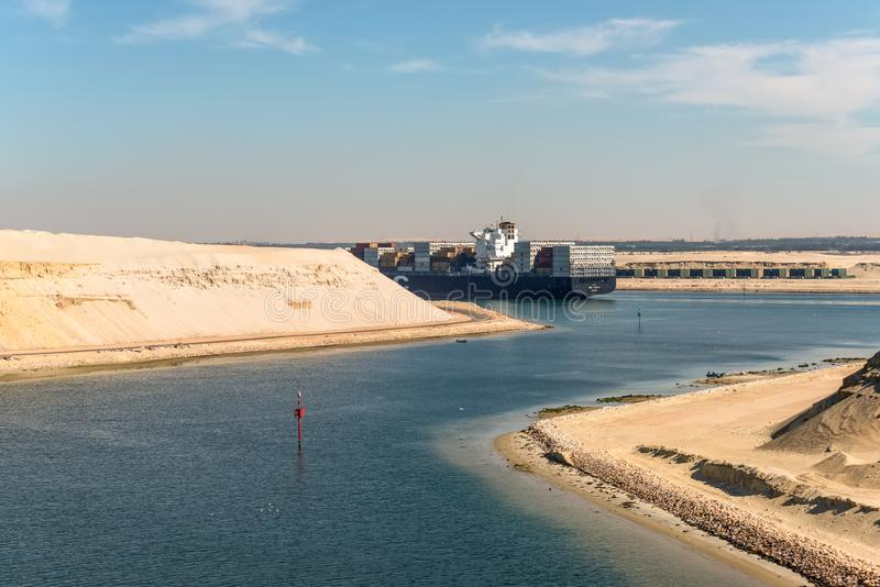 Traffic in New Suez Canal near Ismailia, Egypt, Africa. Ismailia, Egypt - November 5, 2017: Large container vessel MSC Maeva passing the New Suez Canal near royalty free stock photo