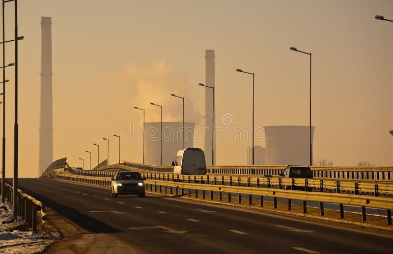 Traffic next to oil refinery royalty free stock images