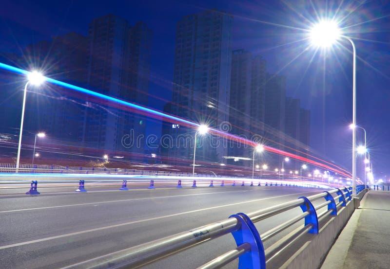 Traffic night. Traffic on the bridge at night royalty free stock photo