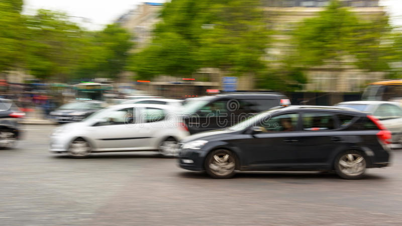 Traffic in Paris. Traffic with motion blur at Place de L'Etoile in Paris, France stock images