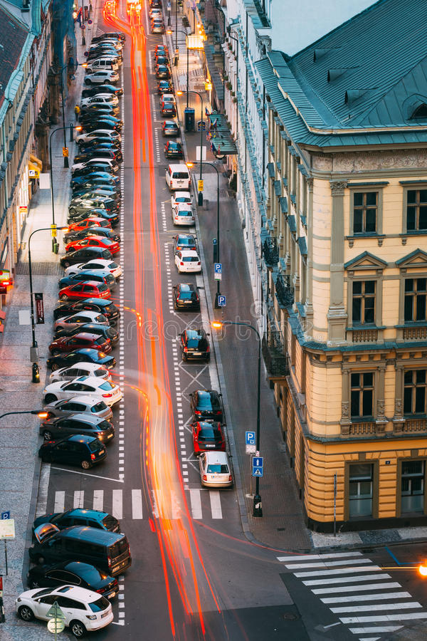 Traffic and parked cars on the Hybernska street in. Prague, Czech Republic - October 13, 2014: Traffic and parked cars on the Hybernska street stock photos