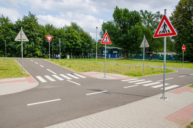 Traffic playground for children, traffic signs. The playground is equipped with vertical and horizontal signs or traffic lights. The area of the stock photo
