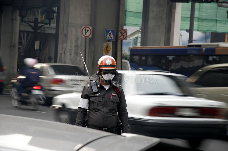 Traffic police in bad environment stock images