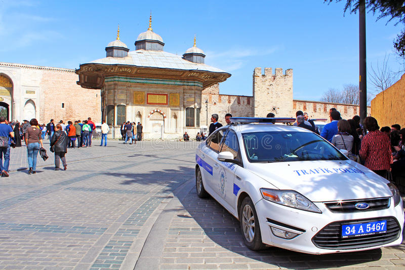 Traffic police car and unidentified tourists on Is stock images