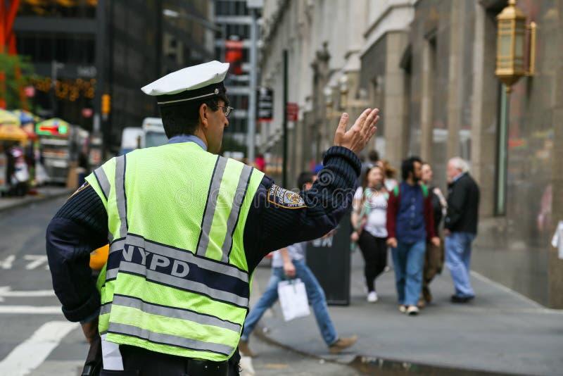 Traffic policeman in NY. New York City, USA - May 19, 2014: A traffic policeman directs traffic near the 9/11 memorial stock image