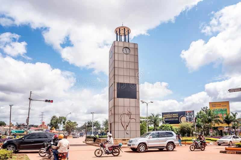 Traffic at Queensway Tower Clock in Kampala city,Uganda. Kampala, Uganda- April 3, 2016: Traffic at Queensway Tower Clock in Kampala city,Uganda stock photo