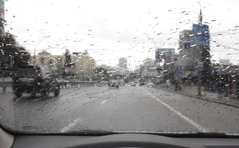 Traffic on the rainy day on the city street. Traffic on the rainy day at the city street from drivers seet