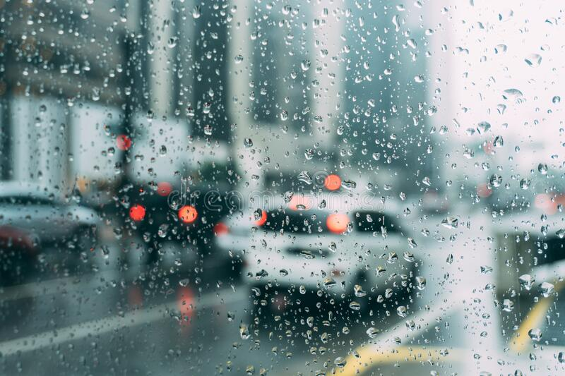 Traffic on rainy streets royalty free stock image