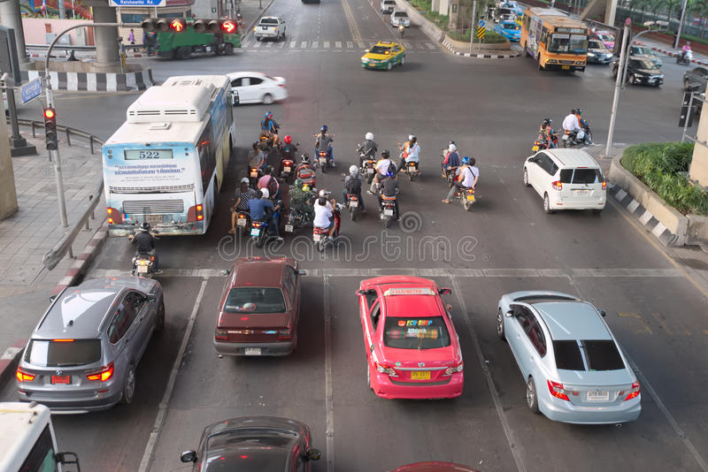Traffic raw violation. Bangkok, Thailand - January 30, 2015 : Various vehicles break law by stop car beyond the white line on the ground during red light. This royalty free stock image