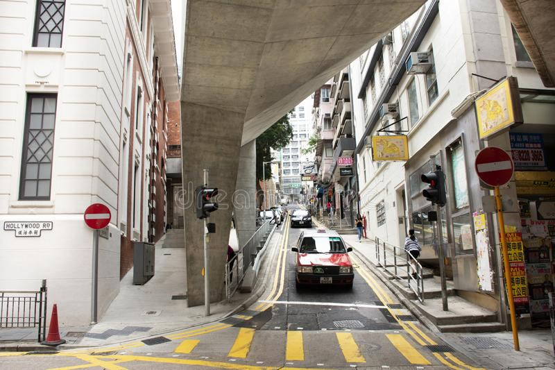 Traffic road and Chinese people with foreigner travelers walking crossing road at Hollywood street in Hong Kong, Chinag stock image