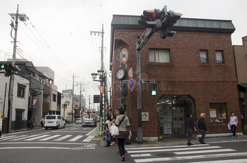 Traffic road with Japanese and foreigner walking and visit street and clay walled warehouse style building at Kawagoe or Little E stock photo