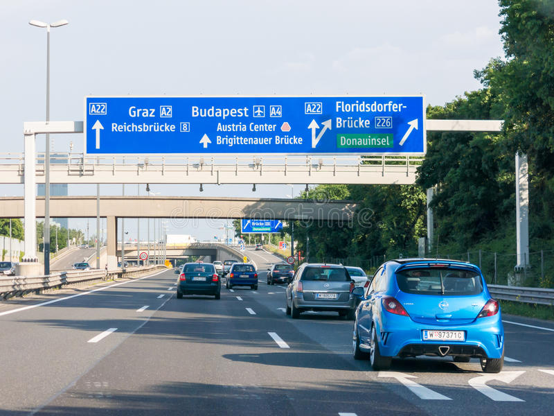 Traffic and road signs on Autobahn A22 in Vienna, Austria. Traffic on highway Autobahn A22 and directional road signs in Vienna stock photo
