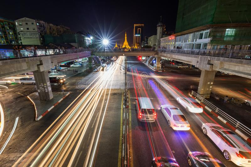 Light trails at the downtown in Yangon at night. Traffic`s light trails and intersection of the Anawrahta and Sule Pagoda Roads at the downtown in Yangon Rangoon stock photography