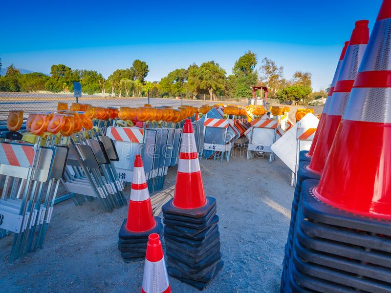 Traffic Safety Cones and Signs. Colorful new traffic safety signs, lights and cones wait at a construction site to be to use royalty free stock photography